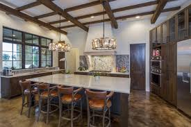 flooring concrete floor and kitchen island with stools plus drum