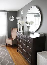 Small Bedroom Dresser With Mirror Round Chrome Metal Frame Wall Mirror Over Espresso High Glossy