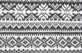 gray background with a knitted pattern sioux falls aa intergroup