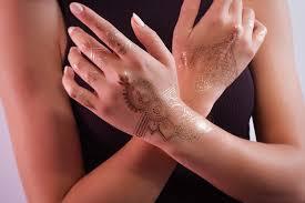 we offer beautiful temporary golden henna tattoos