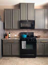 best paint to redo kitchen cabinets painting cabinets how the pros do it paper moon painting