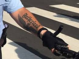philadelphia police investigate officer photographed with tattoo
