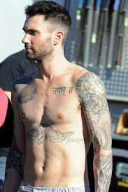 adam levine s meanings and photos
