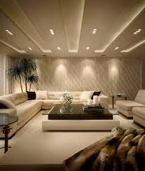 strategic lighting highlights textured living room walls
