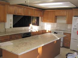 maple cabinets with white countertops golden cabinets stone inc