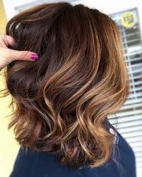 shades of high lights and low lights on layered shaggy medium length 33 light brown hair colors that will take your breath away