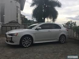 white mitsubishi lancer with black rims listings from cars bikes parts jamdeal