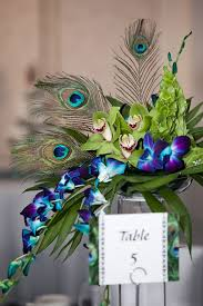 Feather And Flower Centerpieces by Peacock Themed Wedding Ideas Peacocks Centerpieces And Google