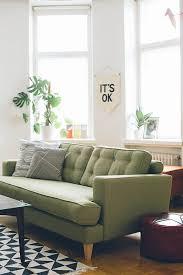 Green Sofa Living Room Minimalist Living Room With Beautiful Soft Green Sofa Hupehome