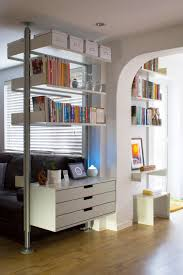 hallway defined via a compressed shelving system 621 table is