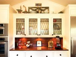 white leaded glass kitchen cabinets traditional white kitchen with leaded glass cabinets hgtv