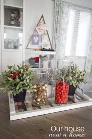 how to decorate with glass hurricanes and lanterns christmas