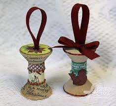 create x3 wooden spool ornaments