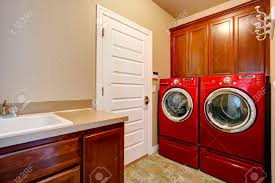 Storage Cabinets For Laundry Room by Laundry Room With Wooden Storage Cabinets Modern Red Washer