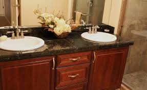 bathroom tile countertop ideas bahtroom beautiful flowers between white sink plus silver crane on