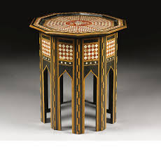 an ottoman tortoiseshell and mother of pearl inlaid coffee table