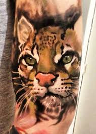 script wild cat tattoo designs wild tattoo design images free