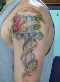 memorial cross with rose tattoo on arm in 2017 real photo