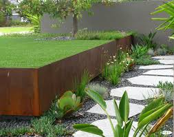 plants at the edges of the walkway create visual interest garden