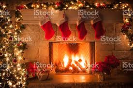 christmas stockings fireplace tree and decorations stock photo