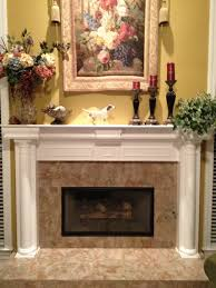 gray stone fireplace mantel with brown wooden shelf also