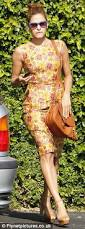 eva mendes channels the fifties look in a floral dress and tan