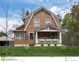 brown house with gambrel roof in springtime stock photo image
