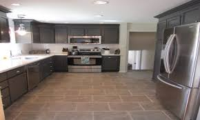 kitchen floors and cabinets white cabinets with dark gray tile