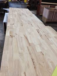 between these walls butcher block top there are a few spots with wood filler that even out knots dings or divots before applying any stain we trimmed it down to it s new length the depth was