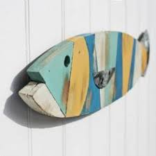 reclaimed barn wood and salvaged metal fish wall most