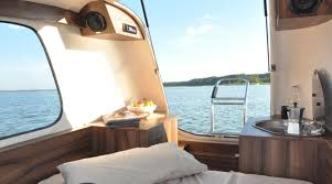 amphibious rv the sealander caravan transforms into an amphibious mini yacht maxim