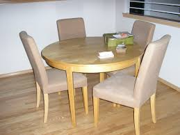 round light wood kitchen dining table and upholstered chairs with