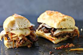 thanksgiving leftover sandwich steak sandwiches with caramelized onions and provolone cheese
