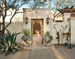 Spanish Houses Rustic Mediterranean Style Spanish Colonial Entry Courtyard Features A Cantera Stone Gate