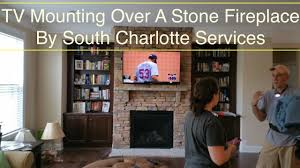 south charlotte tv mounting service over a stone fireplace