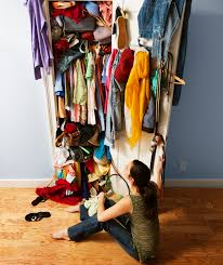 messy closet woman in front of messy closet polished pinterest ageless