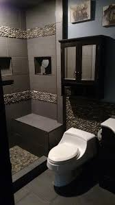 masculine bathroom remodel using bali ocean standing pebble tile
