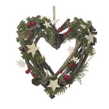 christmas door wreaths and string light garlands at the farthing