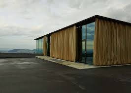 alpine events venue features glass walls with golden outdoor