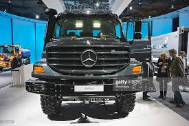mercedes maker visitors look at a mercedes truck at the daimler stand