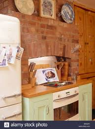 Exposed Brick Wall by Exposed Brick Wall Above Oven And Hob In Pale Green Fitted Kitchen