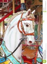 up of carousel horses for children amusement in stock