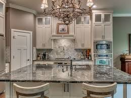 traditional kitchen with l shaped u0026 flat panel cabinets in edmond