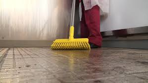 clean surfaces and angles of a wooden table yellow brush cleaning