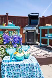 a fence and painting a grilling station