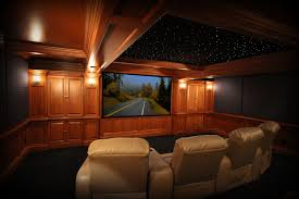 interior opulent black home theater alongside brown wood doff