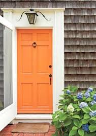 orange door with white trim on brick house for the home