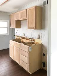 how to paint unfinished cabinets white unfinished wood cabinets to make the flip house kitchen