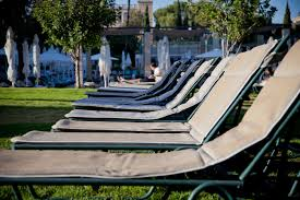Outdoor Furniture Bunnings Simple White Plastic Pool Chairs At The Swimming Pool Stock Photo