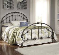 signature design by ashley nashburg queen arched metal bed in